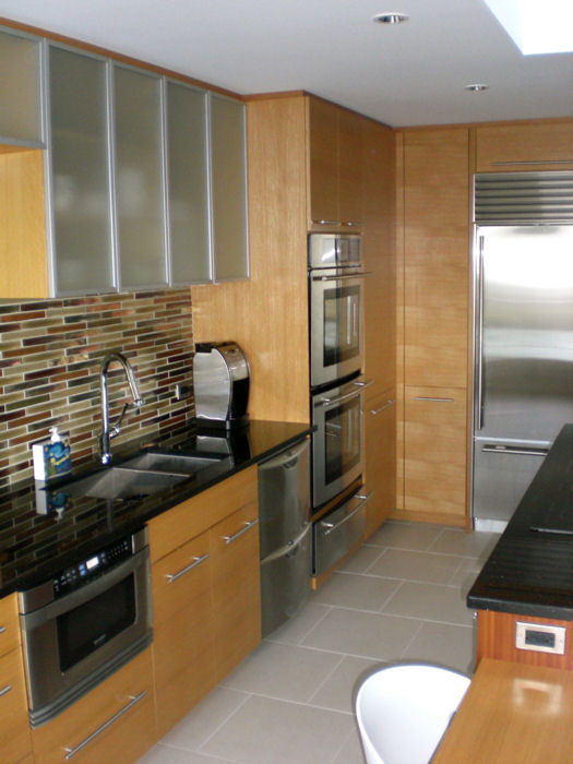 lower wood cabinets and upper cabinets with glass doors