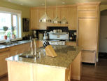 granite top kitchen island and wood cabinets thumbnail
