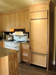 kitchen cabinets with stove and refrigerator thumbnail