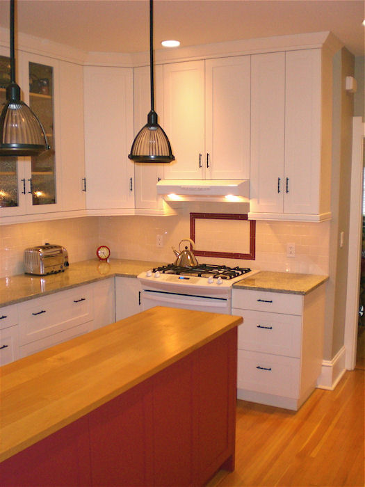 white kitchen cabinets and wood top island