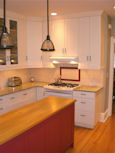 white kitchen cabinets and wood top island thumbnail