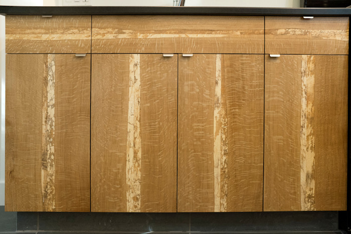 closeup of wood grain kitchen cabinets