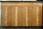 closeup of wood grain kitchen cabinets thumbnail